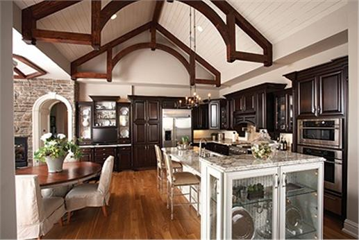 Open floor plan image of kitchen and dining area in vaulted space.